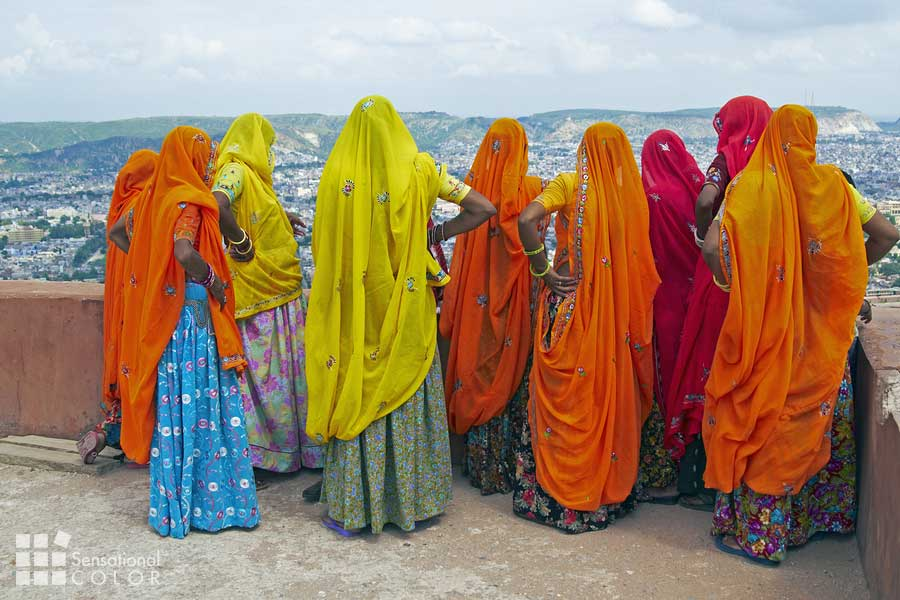 Indian Women In Brightly Colored Saris On The Roof Of A Rajput Palace Tiger Fort In Jaipur