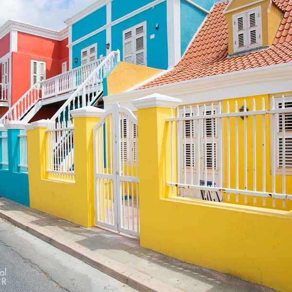 Bright Curacao Colors On Homes