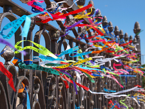Bahia Bands: Brazilian Wish Bracelet Ribbons on a fence at the Church of Senhor do Bonfim