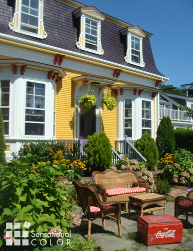 Exterior Color Scheme Stands Out On A Victorian In Provincetown Ma