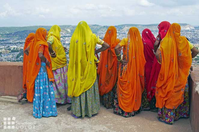 Indian Women In Brightly Colored Saris On The Roof Of A Rajput Palace Tiger Fort In Jaipur The Pink City