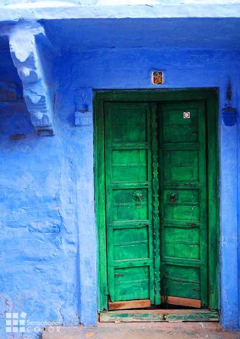 Green door on blue home in the Blue City of Jodhpur, India